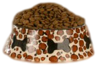 Dog food bowl full of kibble.
